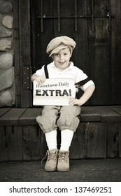 Young newsboy holding his paper with space for a headline