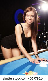 Young nice brunette lady playing roulette