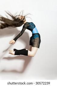 a young nice girl dancing modern dances