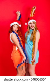 Young nice girls have fun on a christmas party