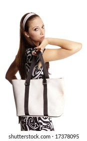 young nice woman holding bag on shoulder