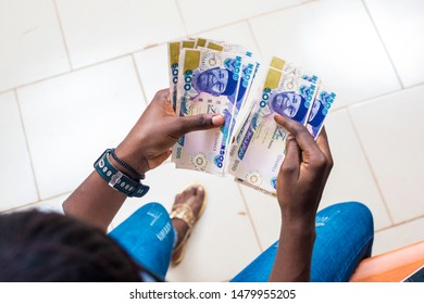 young nigerian lady counting some naira