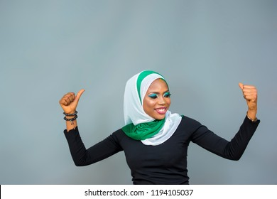 young nigerian muslim woman in jubilant mood