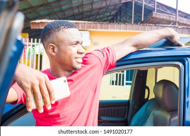 A young Nigerian taxi driver Waiting for passengers