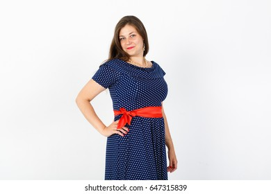 young not thin girl smiling. Chubby young woman. White background. Red lips. Studio photo. Happy elegant lady. Love of herself. Love yourself. Diet, weight loss