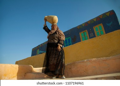 A young  Nubian girl carrying a water the Nile
