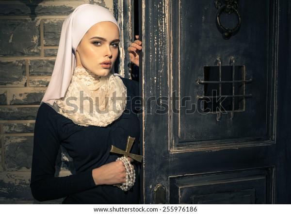 Young nun in the doorway