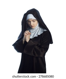 Young nun prays. Photo on white background.