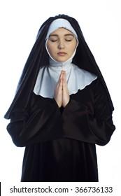 Young nun prays. Photo on white background.
