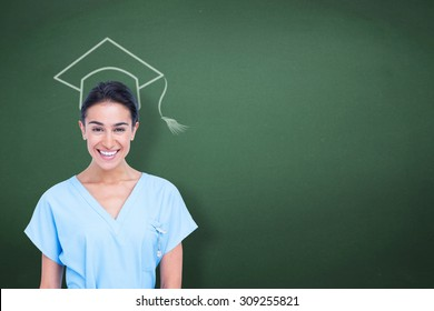 Young nurse in blue tunic against green