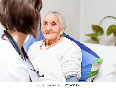 Young  nurse caring for  elderly patients helping their days in nursing home.