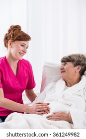 Young nurse is caring for elderly woman