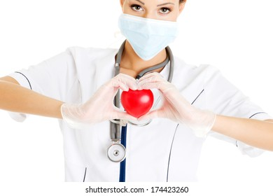 Young nurse with heart in her hand , isolated on white.