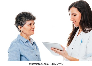 Young nurse holding notebook is giving advice to senior female patient