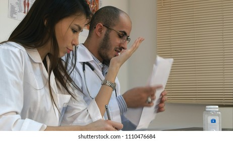 Young nurse and male doctor having an argument in the office