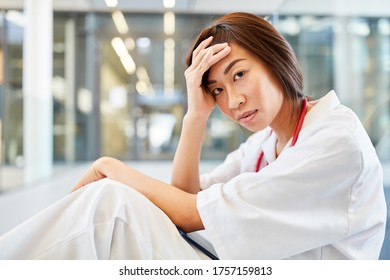 Young nurse or medicine student with stressed facial expression
