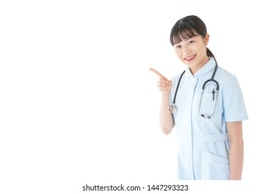 Young nurse pointing at something