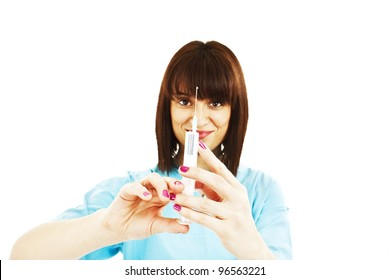 Young nurse is preparing syringe for injection, isolated over white
