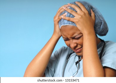 Young nurse stressed out and upset at work