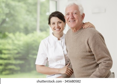 Young nurse taking care of old sick man