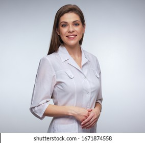 Young nurse in white medical uniform. isolated studio portrait.