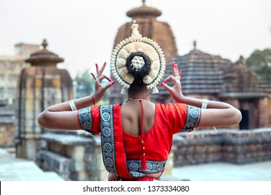 Young odissi female artist shows her inner beauty at Mukteshvara Temple,Bhubaneswar, Odisha, India
