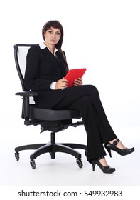 Young office woman with tablet computer in hands, on white background