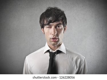 Young office worker squinting one eye