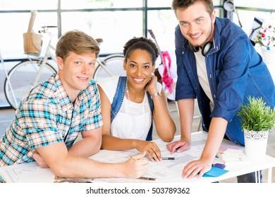 Young office workers or students as a team