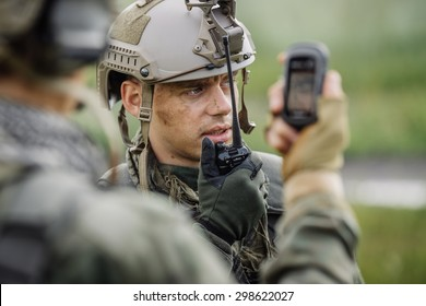 young officer holds a radio station, and give orders subdivision
