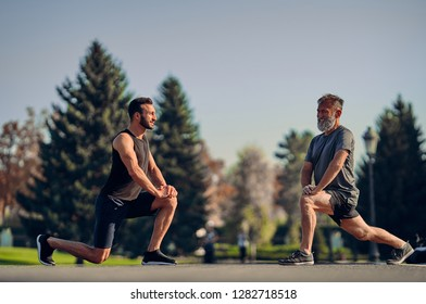 The young and old athletes stretching outdoor