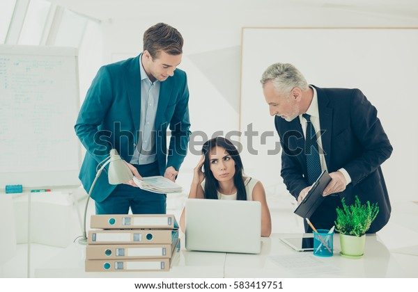 Young and old businessmans and businesswoman at the office can't come to a common understanding