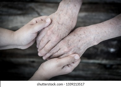 Young and old hands love and care