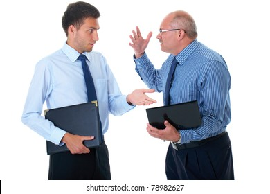 young and older businessman have argument over their work, one of them hold small computer, isolated on white