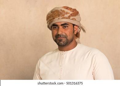Young Omani man in traditional Omani clothing. Nizwa, Oman - 14/OCT/2016
