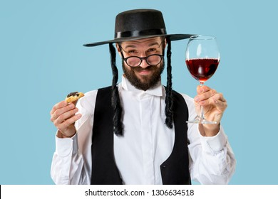 The young orthodox jewish man with hamantaschen cookies for festival Purim. Holiday, celebration, judaism, pastry, tradition, cookie, religion concept