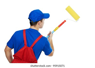 Young painter man in uniform with  paint roller Isolated over white background