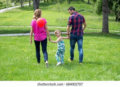 Young parents and his daughter,enjoy in park