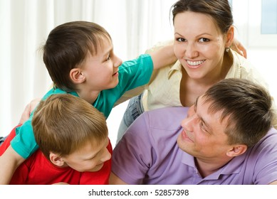 young parents play with their two sons