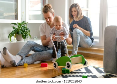 Young parents playing with baby