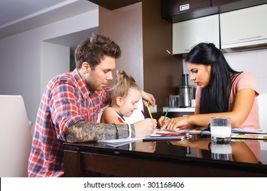 Young parents and their small daughter drawing together, stylish people, hipsters