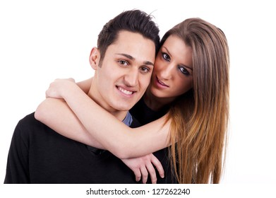 Young passionate couple hugging, kissing and looking each other