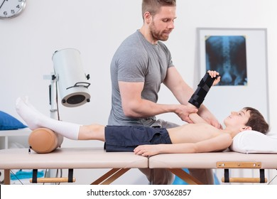 Young patient with broken wrist visiting a physiotherapist