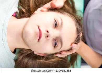 Young patient  undergoing craniosacral biodynamic therapy. Osteopathy manipulation.