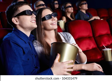 Young people in the 3D glasses at the cinema