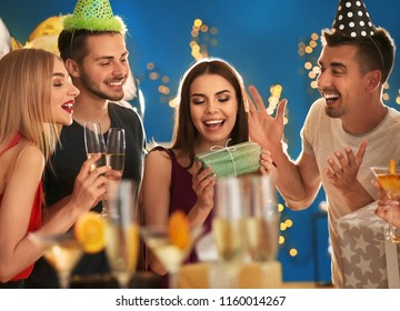 Young people at birthday party in club
