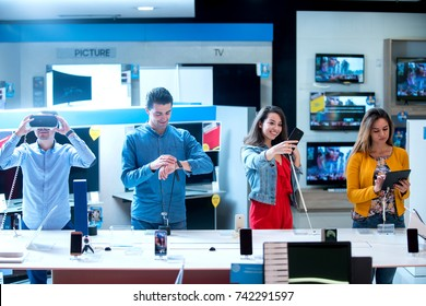 Young people buying latest electronics. shopping.