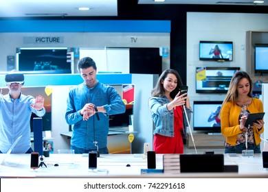 Young people buying latest electronics. shopping.
