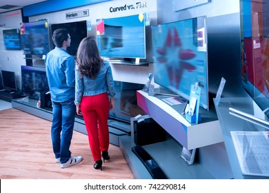 young people buying latest flat tv. shopping, concept