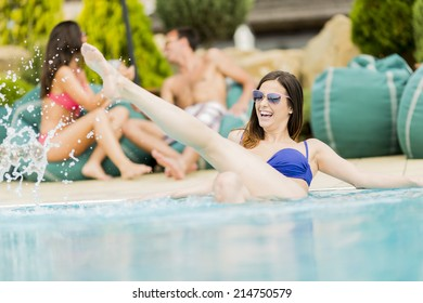 Young people by the swimming pool